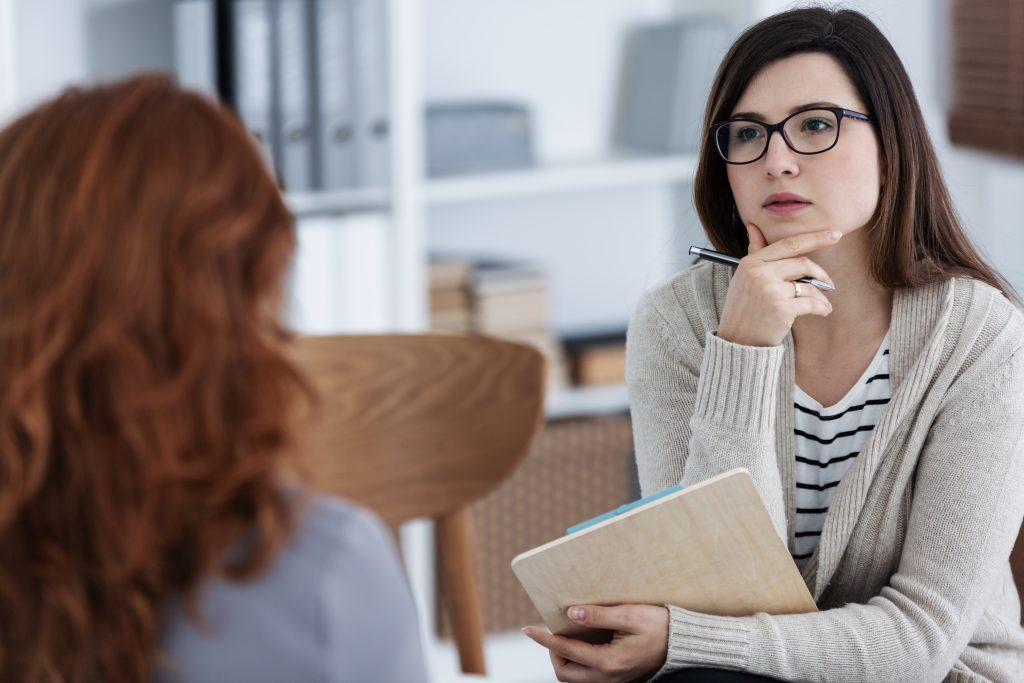 A woman encouraging another to deal with stress