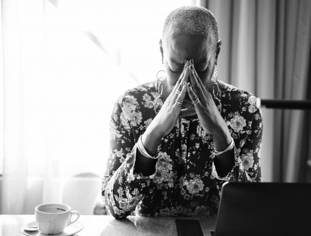 A black woman struggling with anxiety